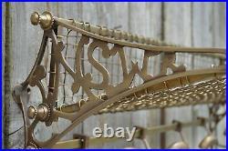 A vintage style solid aged brass railway train luggage rack wall shelf