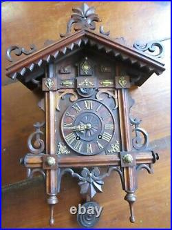 Antique Ca. 1880 Spring Driven Wall Cuckoo Clock with Baroque Type Brass Decor