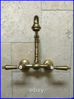 Stunning vintage brass wall mounted mixer taps